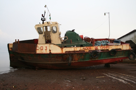 Derelict boat on Campo River, Cameroon.