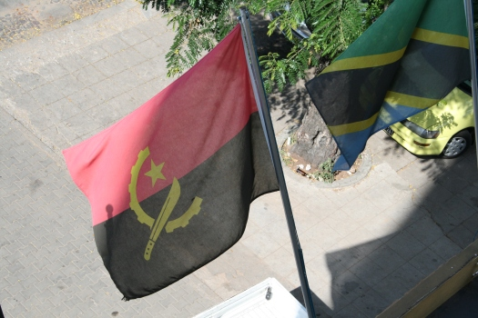 Angolan and Tanzanian flags.